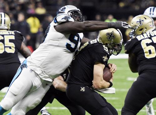 da12beb8d Carolina Panthers defensive end Mario Addison (97) sacks New Orleans Saints  quarterback Drew Brees (9) in the fourth quarter on Sunday